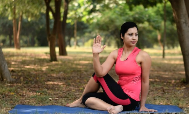 Half Spinal Twist Pose For Weight Loss