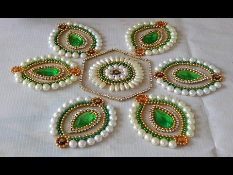 beautiful kundan rangoli design