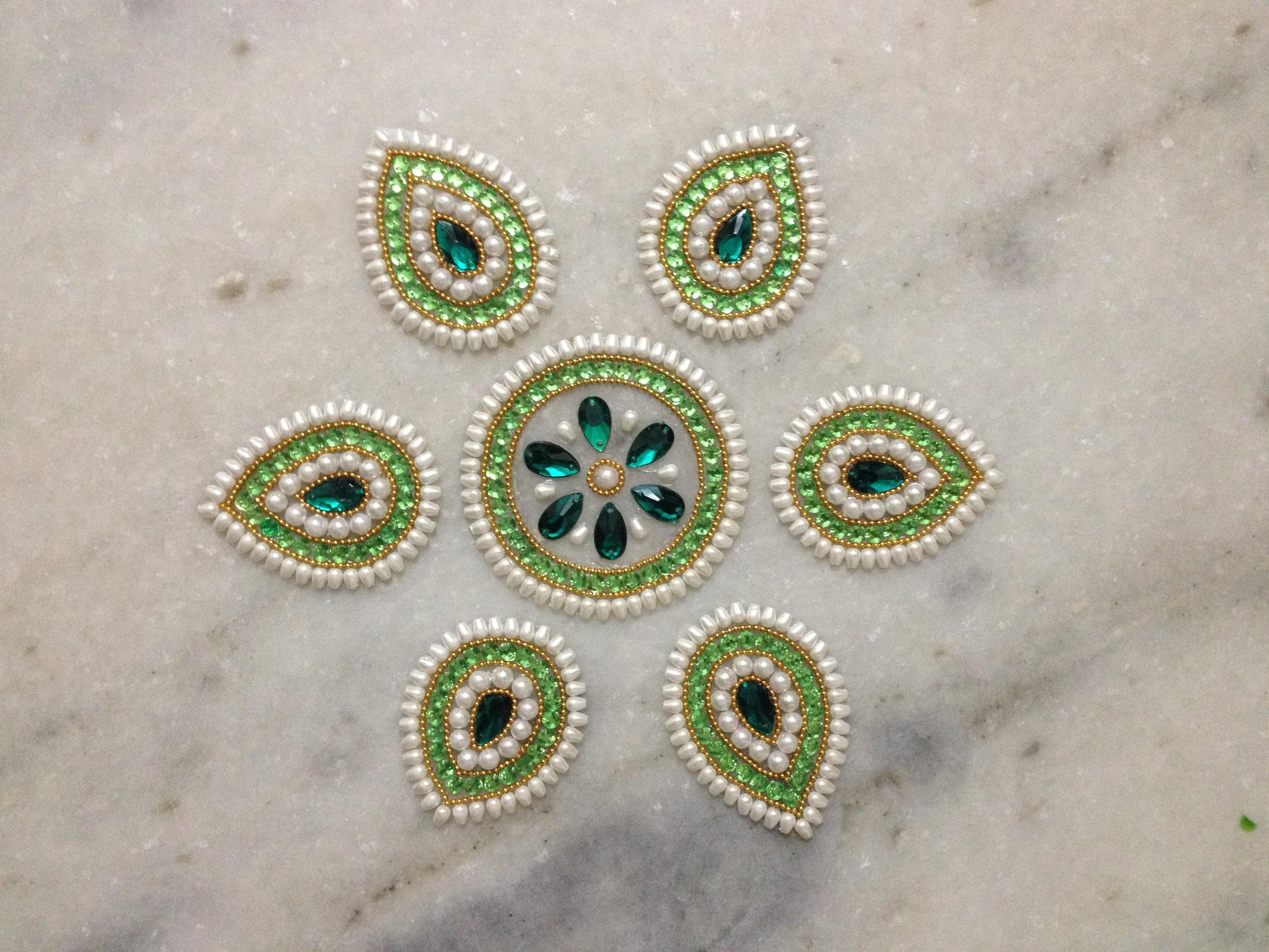 leaves shape kundan rangoli desigsn
